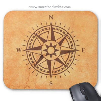 Compass rose on brown stone wall texture mousepad