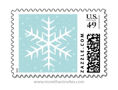 White winter snowflake with snow on pale aqua blue Christmas holiday postage stamps
