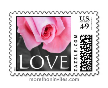 Beautiful pink rose on desaturated background wedding or valentine's day postage stamp with text Love