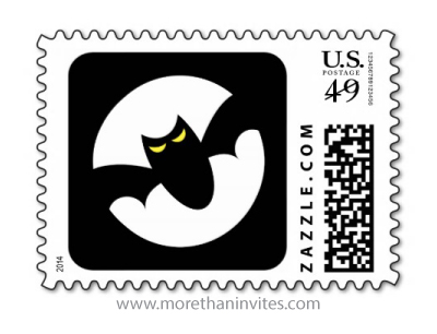 Graphic bat with glowing yellow eyes in front of full moon Halloween postage stamp