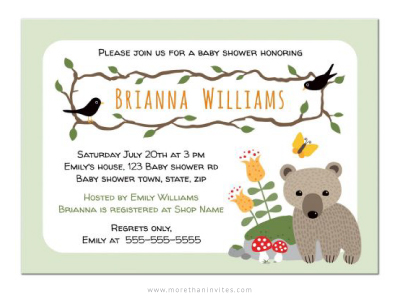Cute woodland baby shower invitation with little bear standing beside a mossy rock