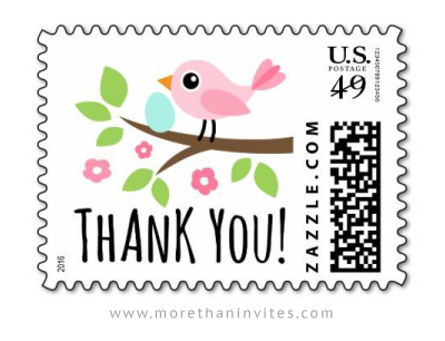 Postage stamp featuring a pink bird with an egg on a flowering branch
