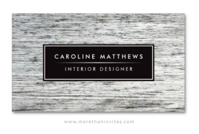 Elegant interior designer business card with light gray wood grain.