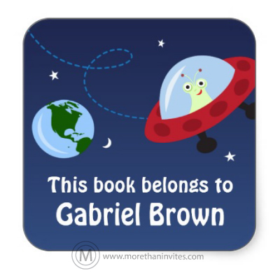 Cute book labels for kids with cute alien in a spaceship flying past planet earth