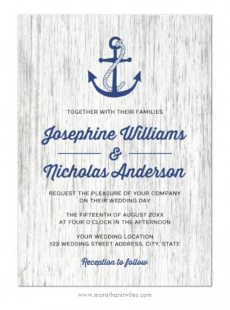 A nautical wedding invite with a navy blue anchor on a rustic wood background