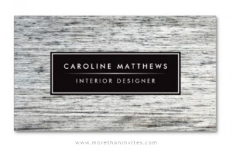 Elegant interior designer business card with light gray wood grain.